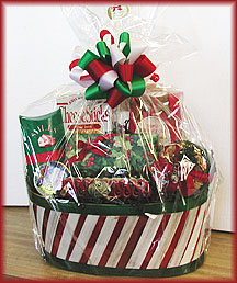 CANDY STRIPES ANYONE? - Candy stripe basket loaded with holiday snacks including cheese sticks, triple chocolate chip cookies, mulling spices, our delicious hand dipped chocolates, jumbo salted cashews, Hammond's famous ribbon candy and holiday Bon Bons.