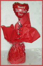 Assorted Valentine candies with mini Valentines Balloon. Inexpensive but cute!