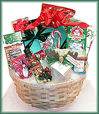 Large Shaker Basket - tri-color tortilla chips, black bean dip, Godiva cocoa, chocolate caramel popcorn, Puff candy, Christmas cake, chocolate covered pretzel logs, large box of Godiva chocolates, taffy, napkins festive